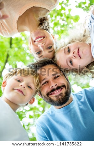 Happy father with family together in harmony