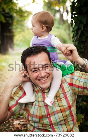 Happy father with his baby daughter outdoors
