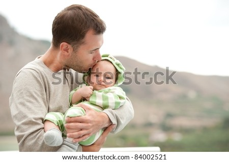 Happy father with his child outdoors.