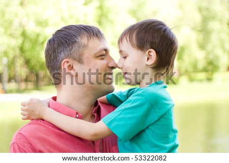 happy father with his son in a summer park