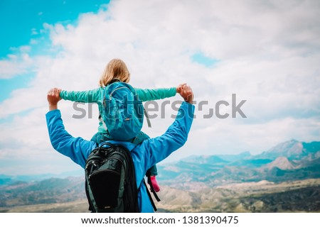happy father with little daughter travel in nature