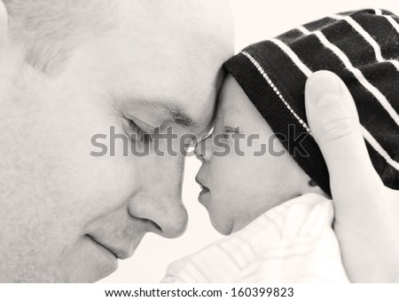 Stock Photo happy father with newborn son on a white background