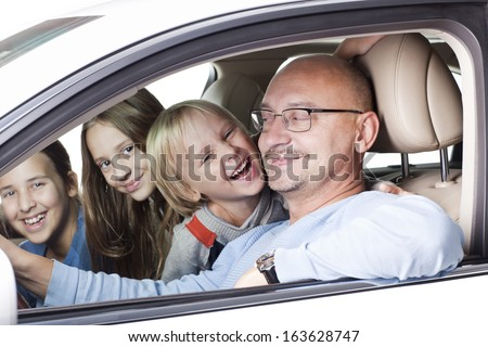happy father with smiling children in the car