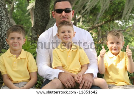 Happy Father with three sons