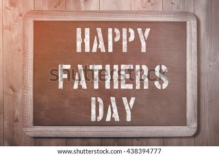 Happy fathers day against chalkboard on desk #438394777