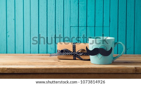 Happy Fathers day concept with coffee cup, mustache and gift box over wooden background #1073814926