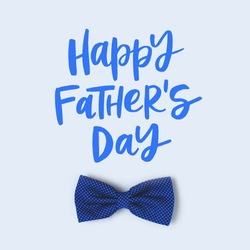 Happy Fathers Day. Festive concept with bow tie on a blue pastel background.
