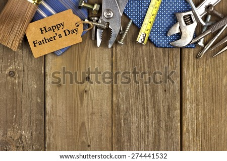Happy Fathers Day gift tag with top border of tools and ties on a rustic wood background #274441532