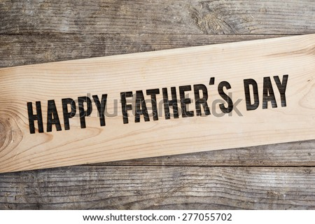 Happy fathers day sign on wooden boards background. #277055702