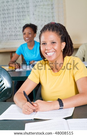 happy female african american adult students in classroom