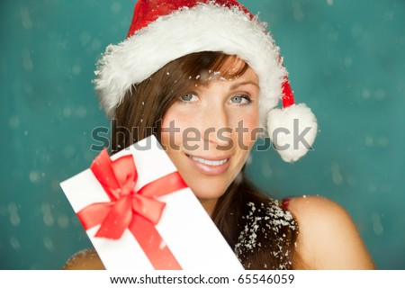 Happy female angel wth white wings holding present gift