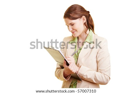 Happy female coach holding clipboard and pen