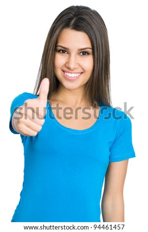 Happy female college student showing thumbs up