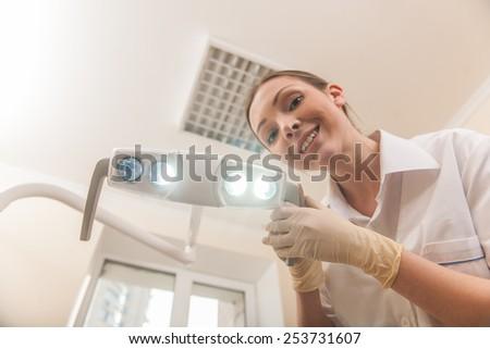 Happy female dentist doctor smiling in camera. Happy female dentist doctor smiling in camera