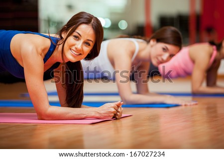 Stock Photo Happy female friends exercising and having fun in a gym class