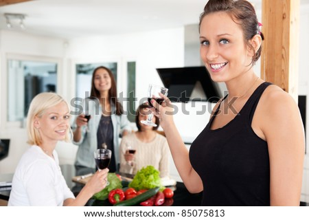 Happy female friends having a casual party at home