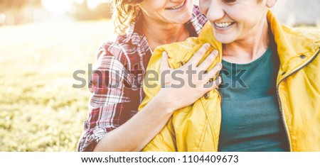 Happy female gay couple having tender love moments - Young partners women hugging in a date - Homosexuality lifestyle, lgbt, female rights and relationship concept - Main focus on hand #1104409673