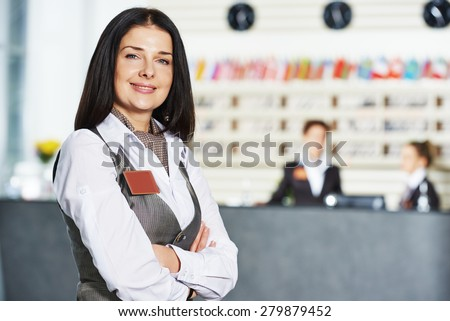 Happy female manager worker standing at hotel