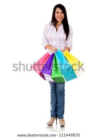 Happy female shopper with shopping bags - isolated over a white background