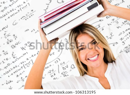 Happy female student carrying books and smiling