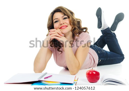 Happy female student studying on floor isolated on white background - stock photo