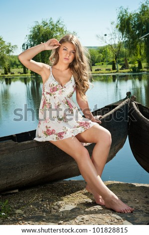 Happy female tourist, having fun on old boat, summertime sailing vacation, beautiful woman outdoor, sexy fit body lady, blonde in dress