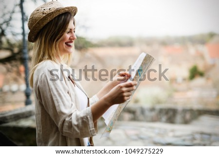 Happy female tourist sightseeing and exploring #1049275229
