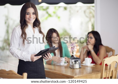 Happy female waitress loving her job and taking care of their customers - stock photo