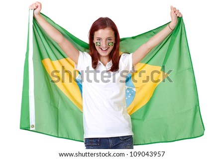 Happy female with Brazil flags on her cheeks, isolated on white