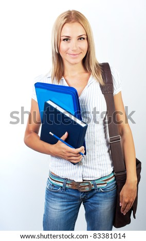 Happy female, young pretty teen student, girl holding books,  portrait