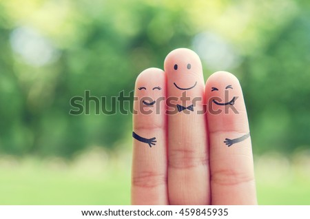 Happy finger art family group of loving mother and father with son while smiley face at blurred outdoor park background. Retro filter effect. copy space.