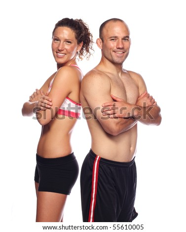 Happy, Fit couple standing back to back