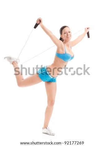 happy fitness girl posing with jumping rope on white background