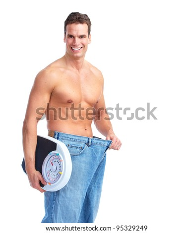 Happy Fitness man with a scales. Isolated on white background.