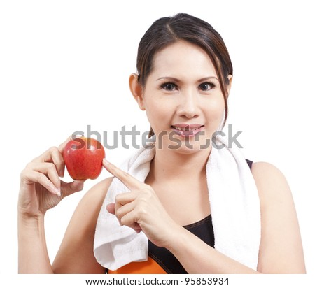 happy fitness woman holding an apple