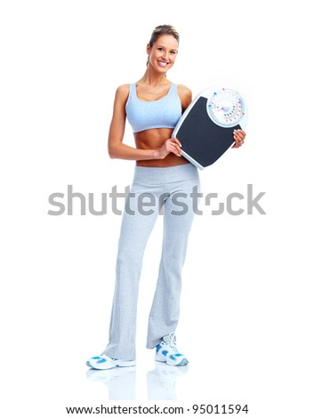 Happy Fitness woman with scales. Isolated on white background.