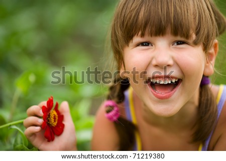 Happy five years Girl laughing outdoors headshot