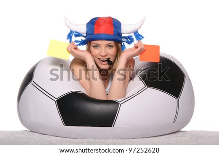 Happy football and soccer supporter with red and yellow cards on white background - stock photo
