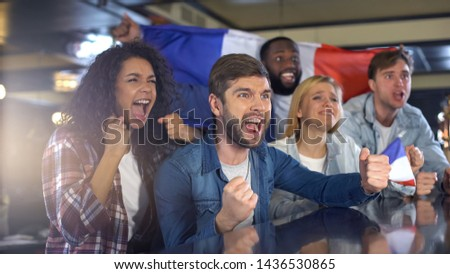 Happy football fans with French flag celebrating victory in tournament, patriots #1436530865