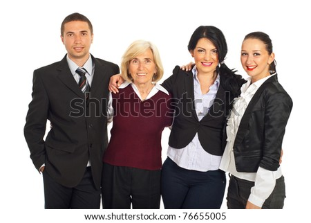 Happy four business people standing in a huddle and smiling isolated on white background