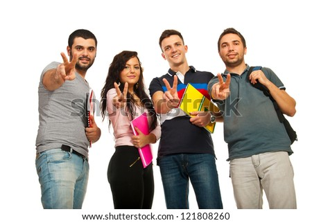 Happy four students showing victory hands gesture isolated on white background
