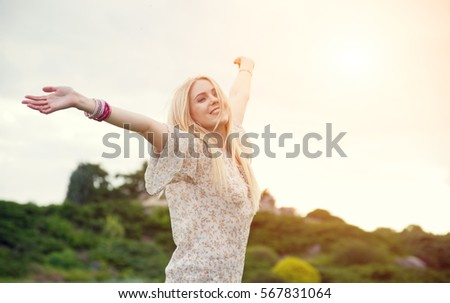 Happy free woman at sunset. Beautiful girl enjoying and happy - freedom concept. Dreams.