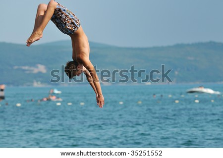 happy friend  boys group have fun and jump in sea at summer vacation