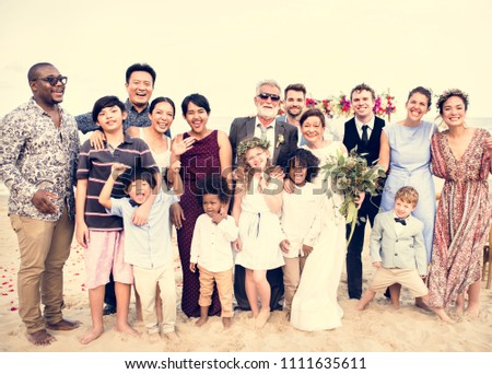 Happy friends and family at a wedding party #1111635611