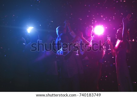 happy friends celebrating new year at night club classy people enjoying life dancing