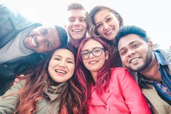 Happy friends from diverse cultures and races taking selfie - Students having fun with technology trends at erasmus university - Youth, tech and friendship concept  - Main focus on bottom girls