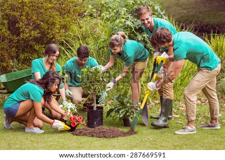 Happy friends gardening for the community on a sunny day #287669591