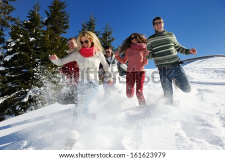 happy friends have fun at winter on fresh snow healthy young people group outdoor