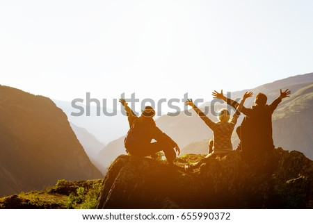 Happy friends having fun at sunset time in mountains range backdrop. Space for text #655990372