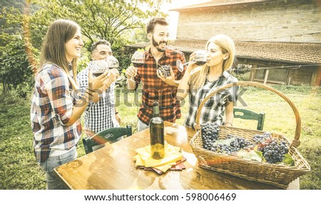 Happy friends having fun drinking at winery vineyard - Friendship concept with young people enjoying harvest together at farmhouse - Red wine tasting at indie experience outdoor - Vintage retro filter